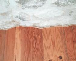 Hardwood Cut Tight to Rock Wall